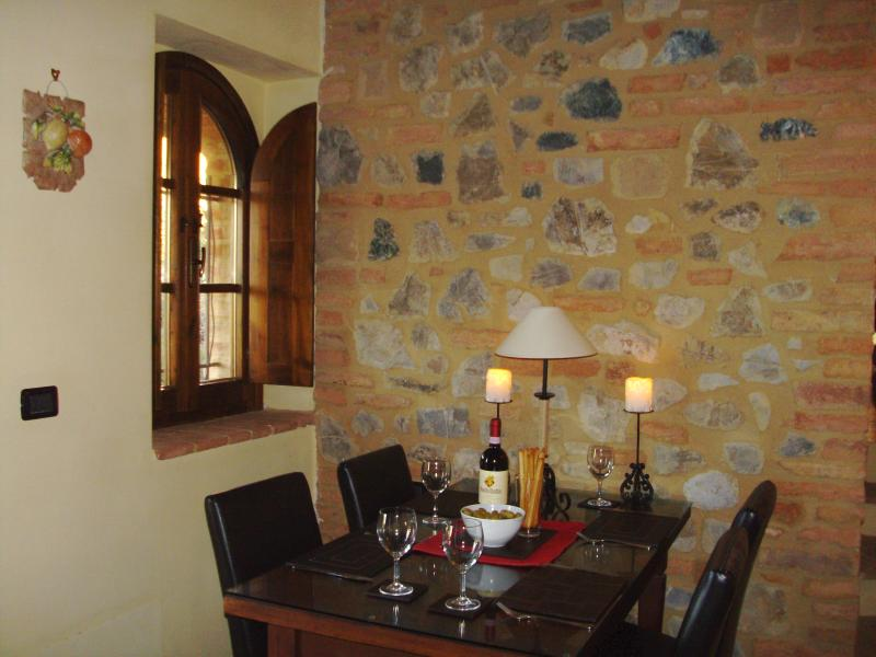 The dining area with exposed stone wall