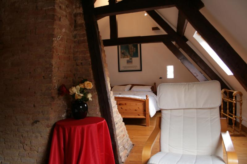Upstairs double bedroom with cot