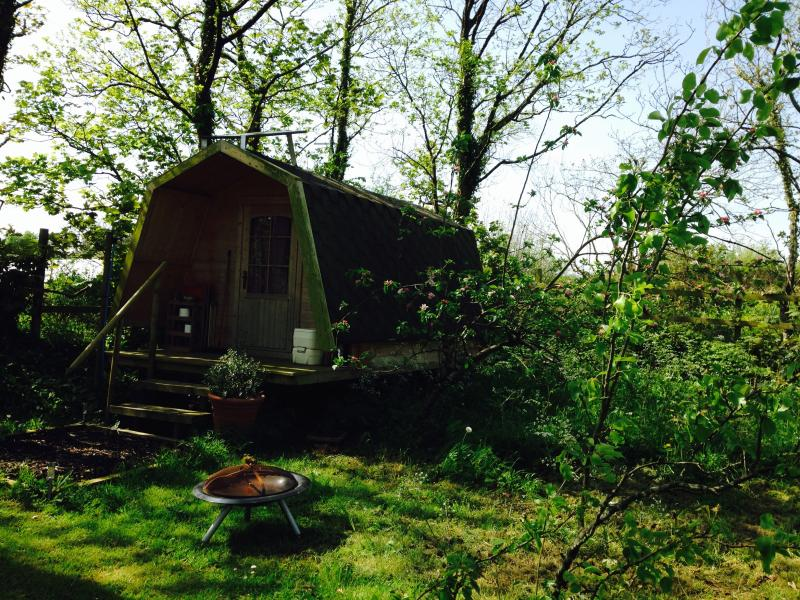 Cabin fitted with solar panel for lighting and a plug socket.