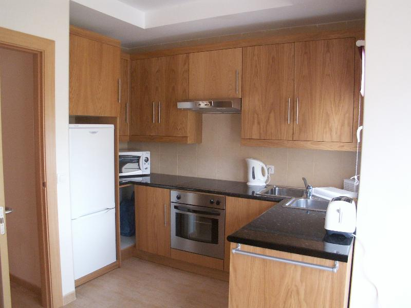 Hand-made well equiped kitchen with full fridge/freezer, hob, extractor, oven, washing machine, micr