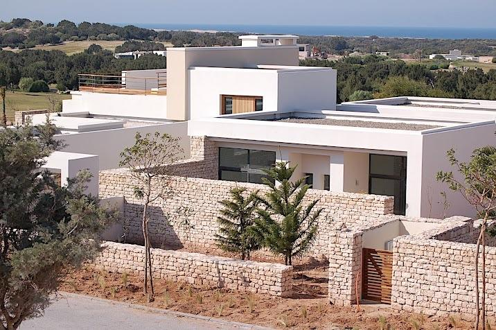 view from street, very discrete with plenty of privacy, golf and ocean in the background