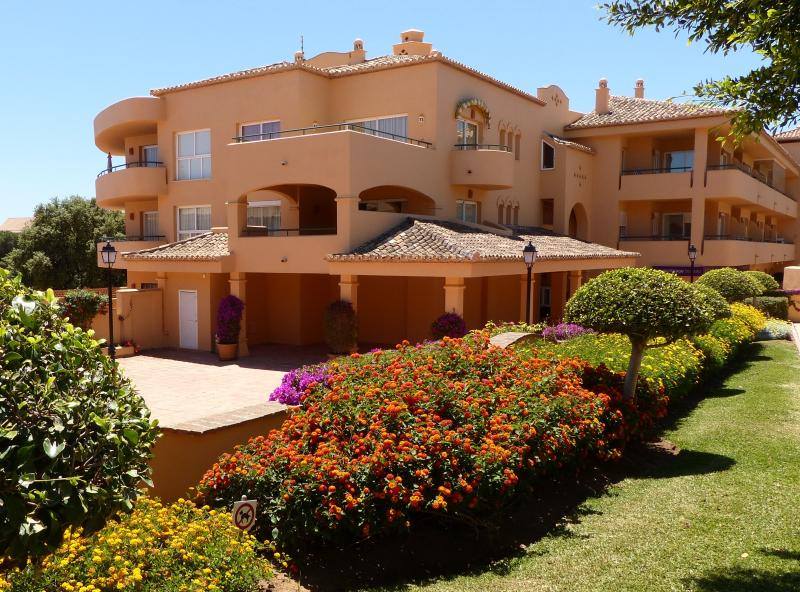 The apartment is set amongst beautifully manicured gardens within a gated complex.