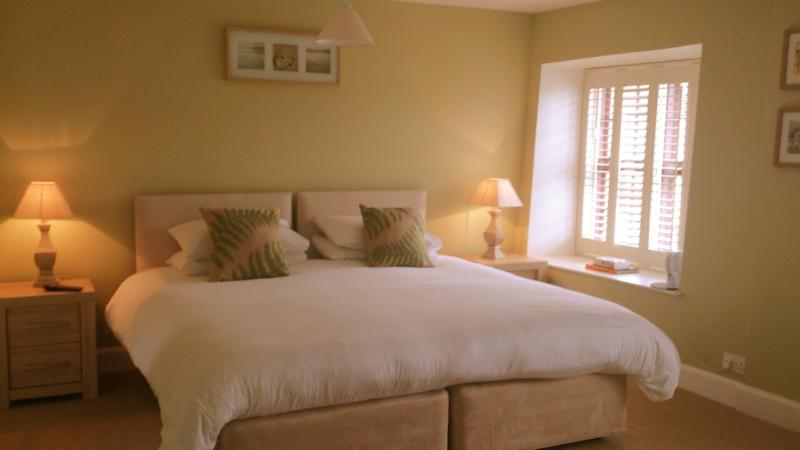 Our upstairs very spacious Room 2 can be a superking zipandlock, twin or can accomodate an extra bed