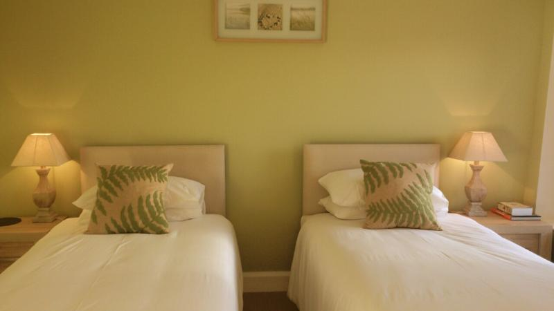 Large and wonderfully comfortable twin room, upstairs, double windows with wooden shutters.