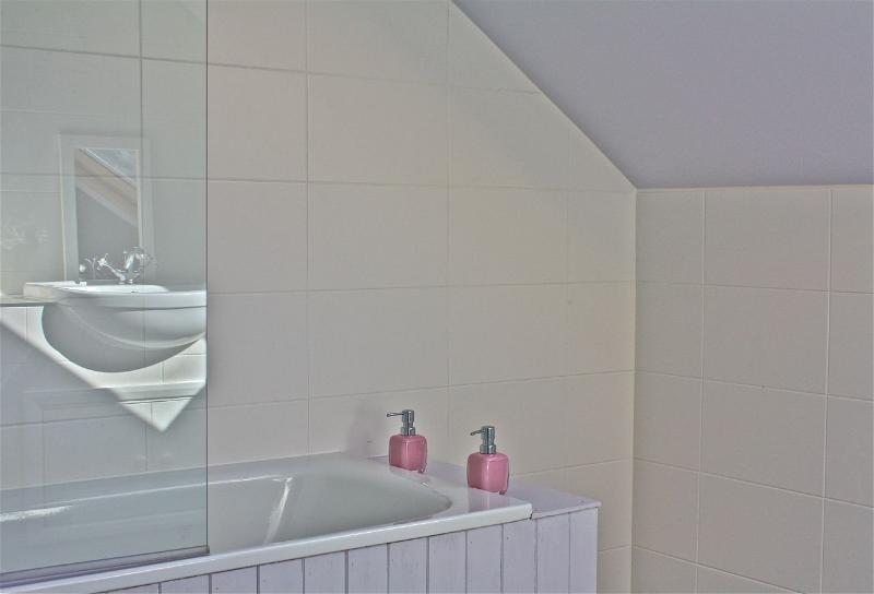 Simple,clean and fresh, bath with shower and views over the fields.