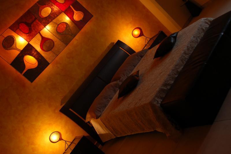 camera da letto con volte a stella e pietra a vista appartamento Penelope