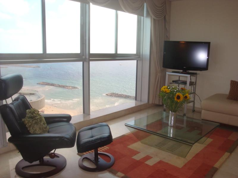 Living room: Flat screen TV & new contemporary furnishings. Wall to wall ocean views.