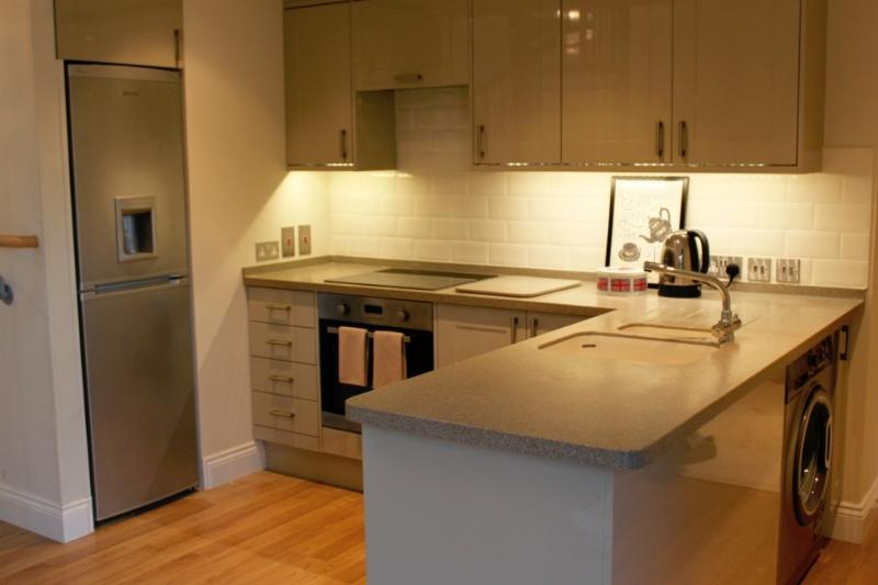 Beautiful fitted kitchen with corian worksurfaces