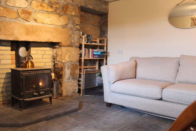 Lounge with large sofa (double sofabed) and main woodburner