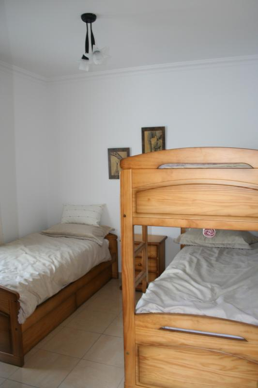 Bedroom 3 with bunk beds and trundle