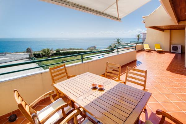 Wooden table and chairs, sun lounges and a BBQ are all provided to help make your stay as enjoyable
