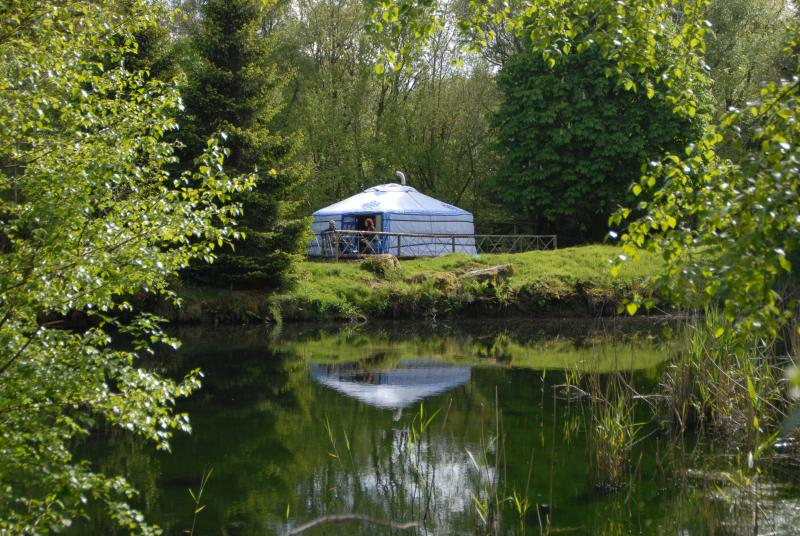 Idyllic Lake Yurt nestled on the edge of a small lake and surrounded by woodland
