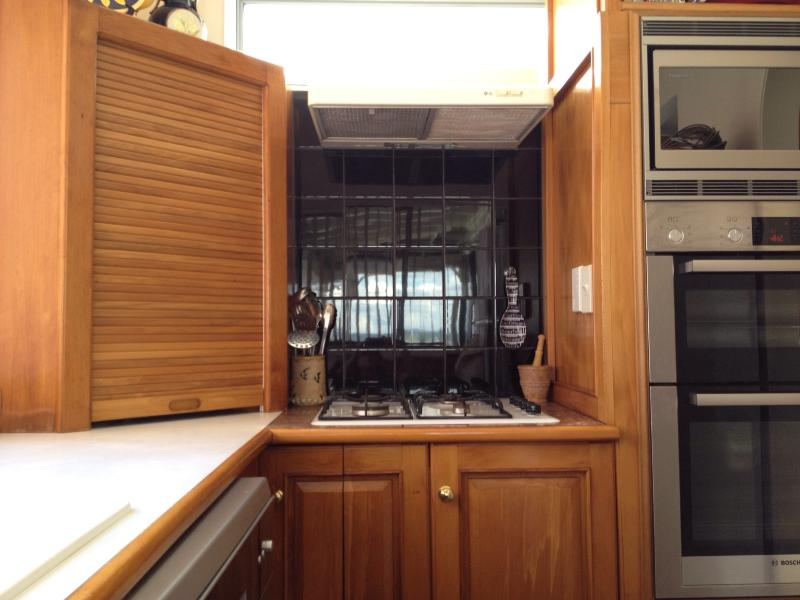 Kitchen with gas hobs, quality two door oven, microwave and dishwasher.
