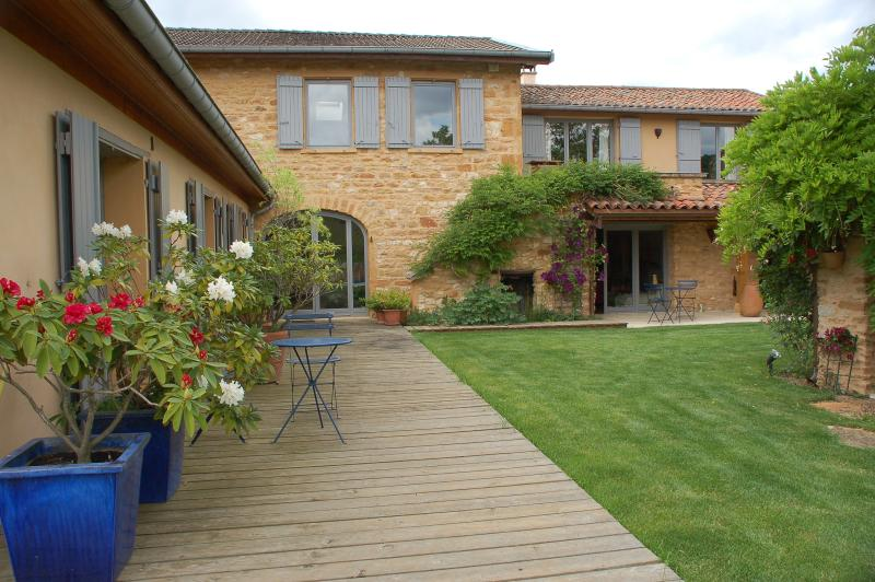 Front of the stone house showing the french doors opening onto the garden courtyard.