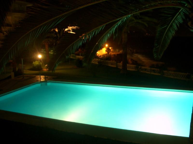 Pool at Night from Apartment Balcony