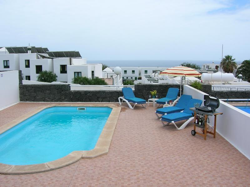 Enjoy a BBQ and the sea views at your private pool