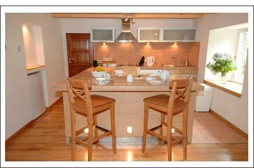 Sit & chat to the cook in this spacious modern & very well equipped kitchen