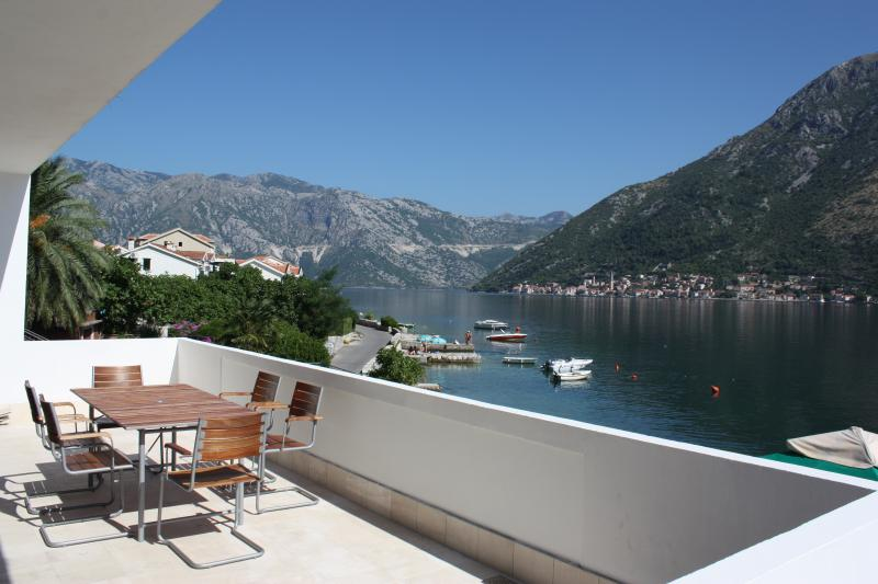 View of Perast from the spacious terrace with alfresco dining for 6