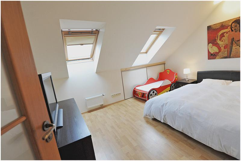 Bedroom with double bed, kids bed, baby cot.