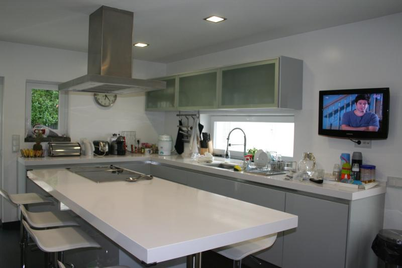 Modern Equipped kitchen with TV