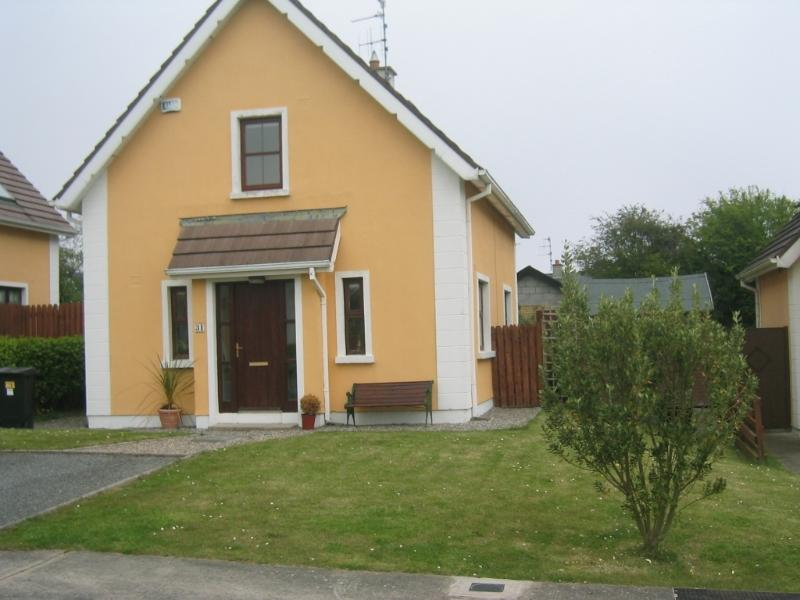 Front View, parking for two cars, garden bench, lawned front and side garden, access gate to rear