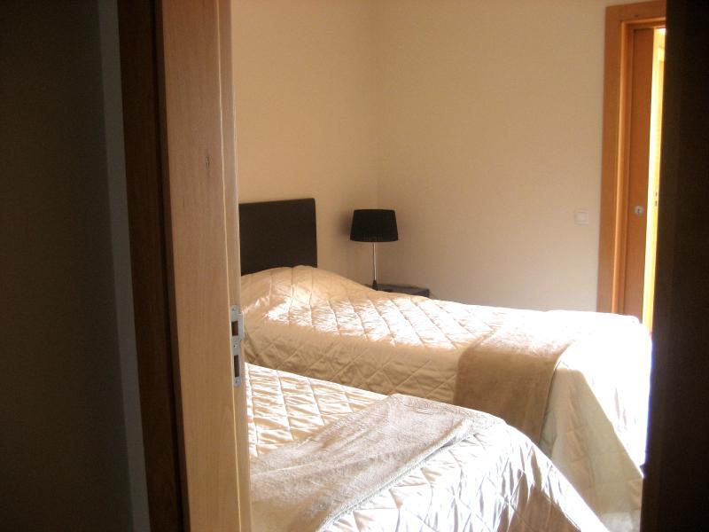 Tweede slaapkamer gebied - 2 eenpersoonsbedden