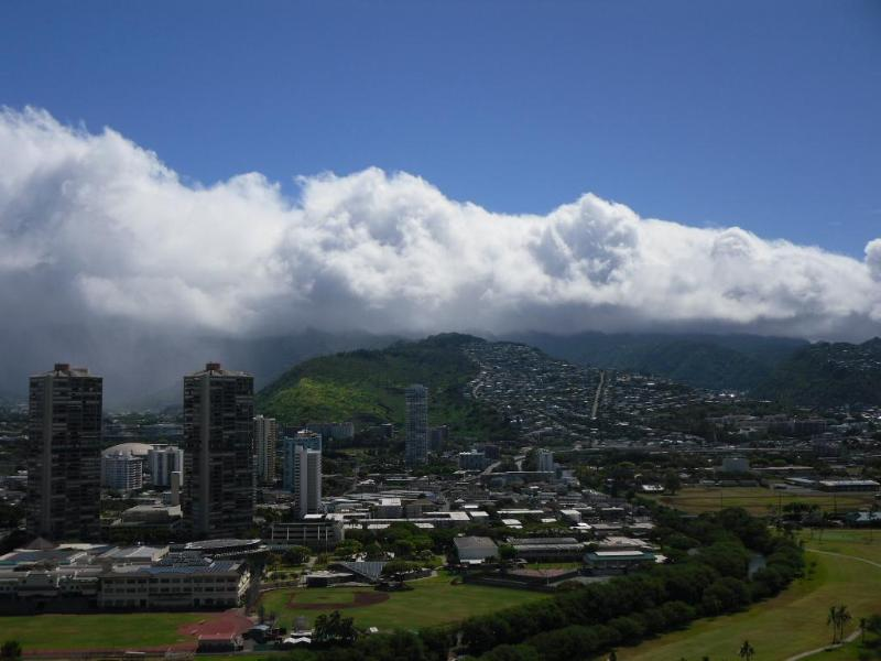 Clouds cresting the Koolau mountains