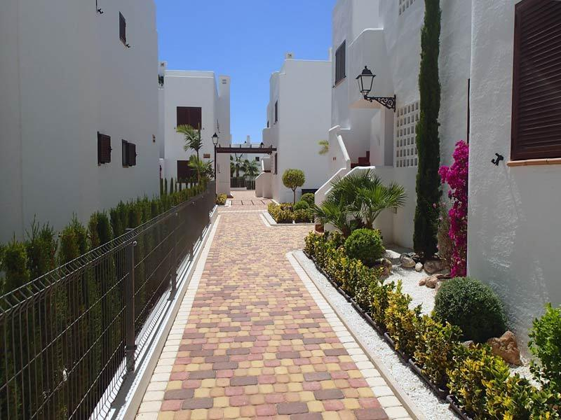 Beautifully maintained gardens behind gated community