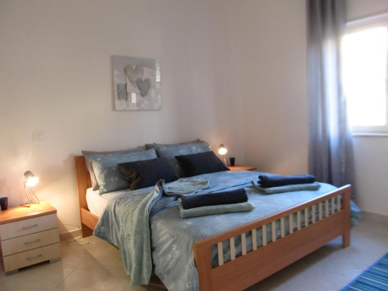 Master bedroom with large memory foam mattress