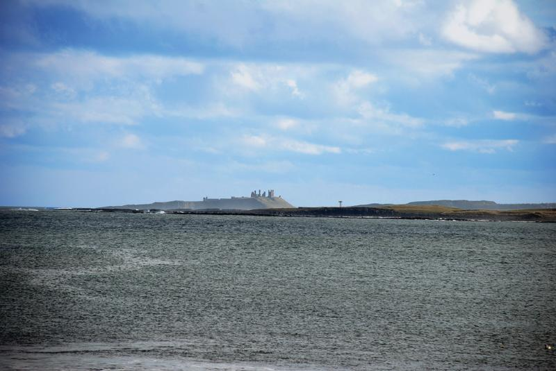 View from Beadnell bay looking towards Dunstanburgh castle