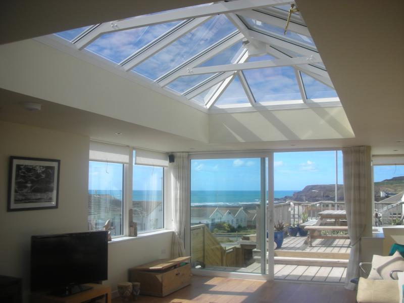 Huge sun lounge with lantern roof and triple aspect windows with views of the sea & cliffs