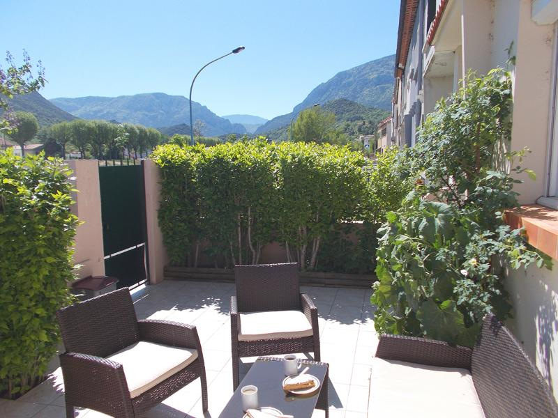 Relax on the front sun terrace, with a view of the hills.