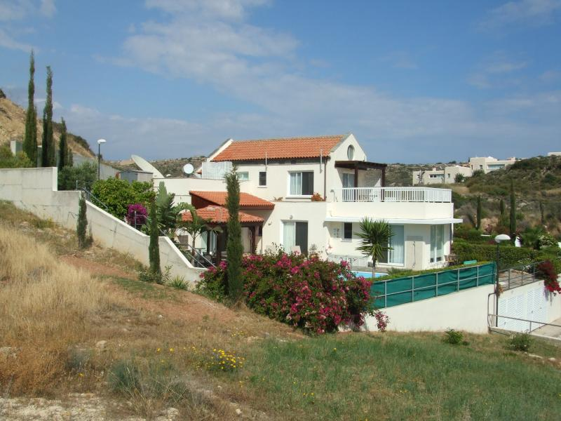 villa from hillside, showing upper terrace , bedrooms and pool area, stunning views from every angle