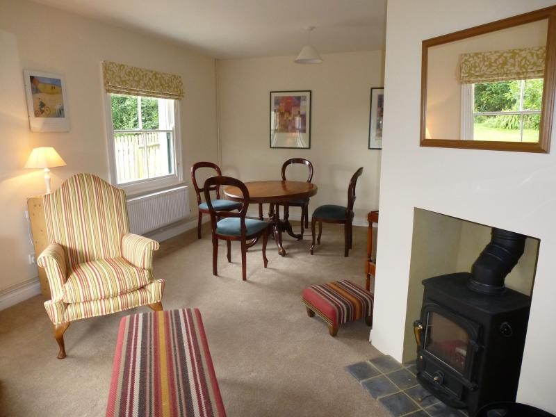 Living / dining room with home entertainment and log burner