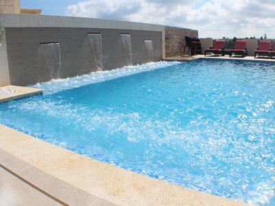 Large Pool with jacuzzi and fountains, sunbathing platform