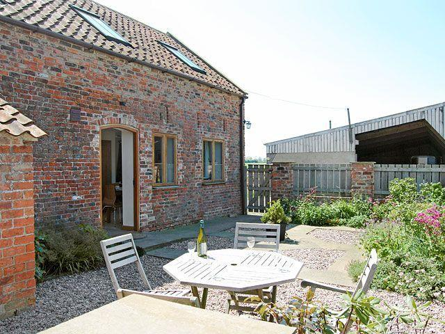 Private walled garden with seated area for al fresco dining - if it's sunny