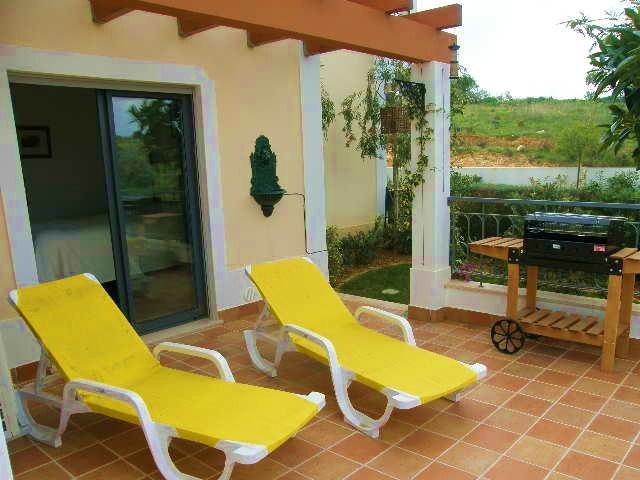 Rear private garden with sun loungers