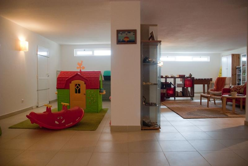 Basement salon, with kids toys and games