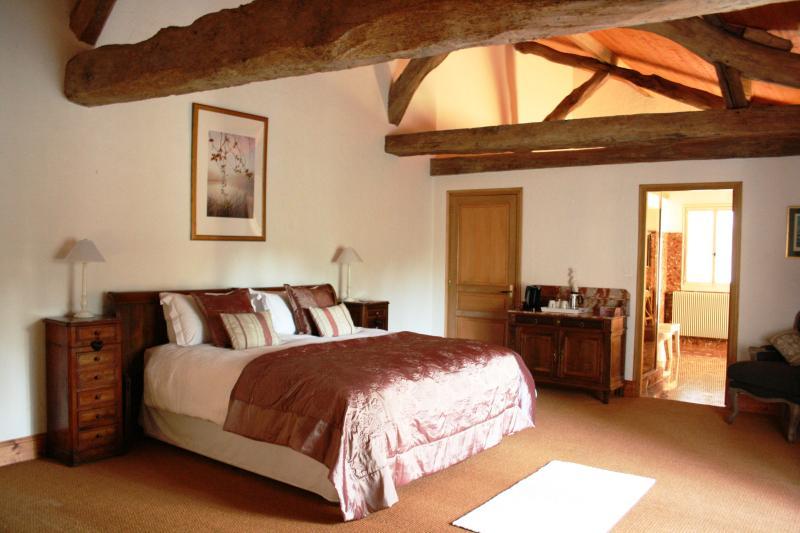 Large open beamed ceilings in the luxury bedroom