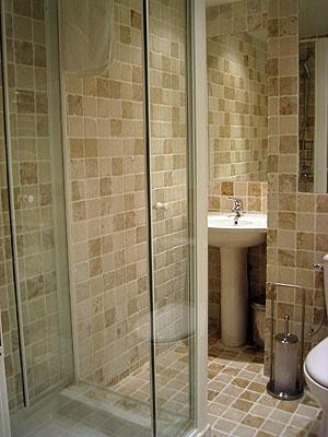 French Stone Tiled Shower room.