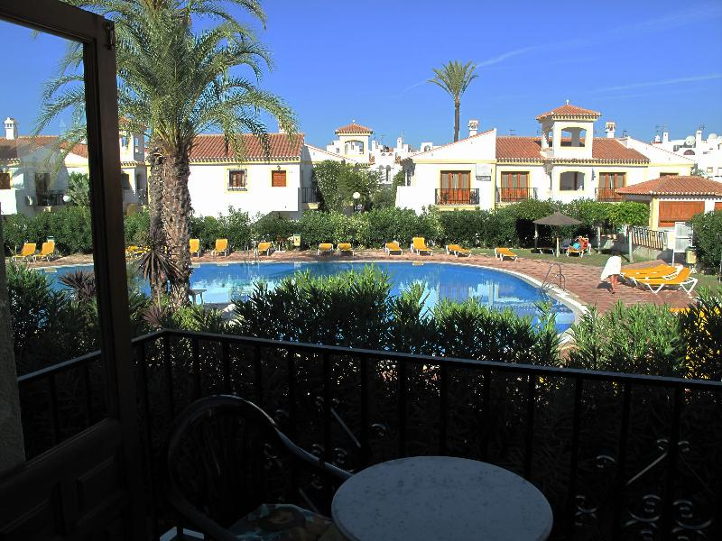 View of  one pool  from front balcony sunbeds provided and showers etc by pool childrens end too.