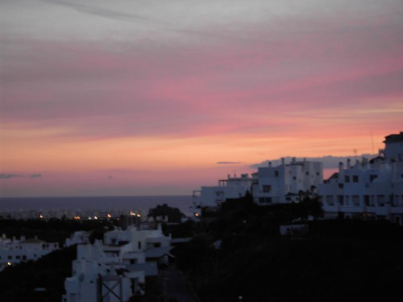 Magical Evening - view from the terrace as the sun's setting.Glass of wine, warm evening air =