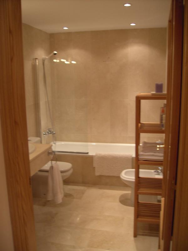 Master En suite - all marble with large bath and twin basins.