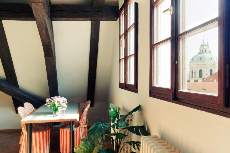 Dining with St. Nicholas Church through window