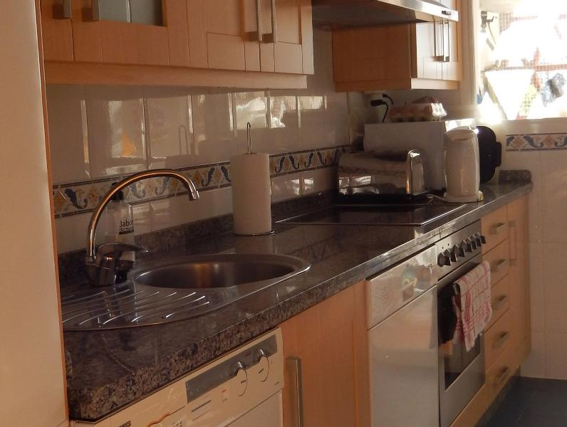 Light Fully Fitted Kitchen, washing machine, microwave, freezer, toaster, iron, and kettle.