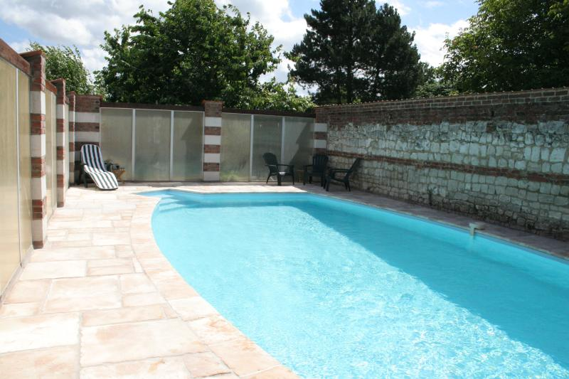 The sheltered and sun trap heated pool area with secure and lockable gate