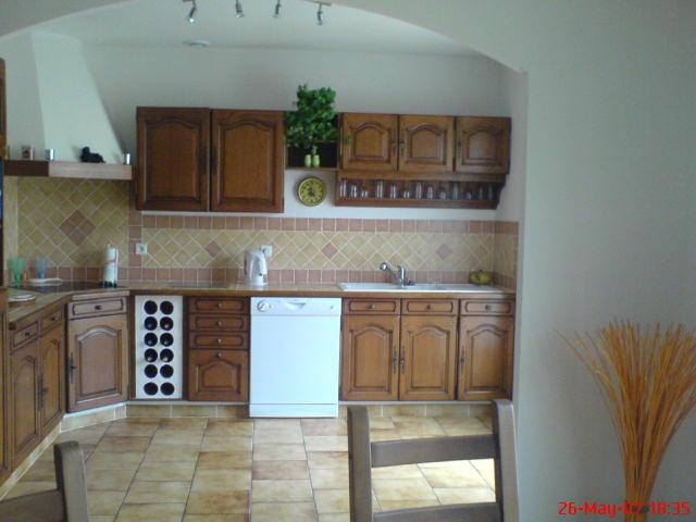 Kitchen Area with Patio Doors leading to Pool