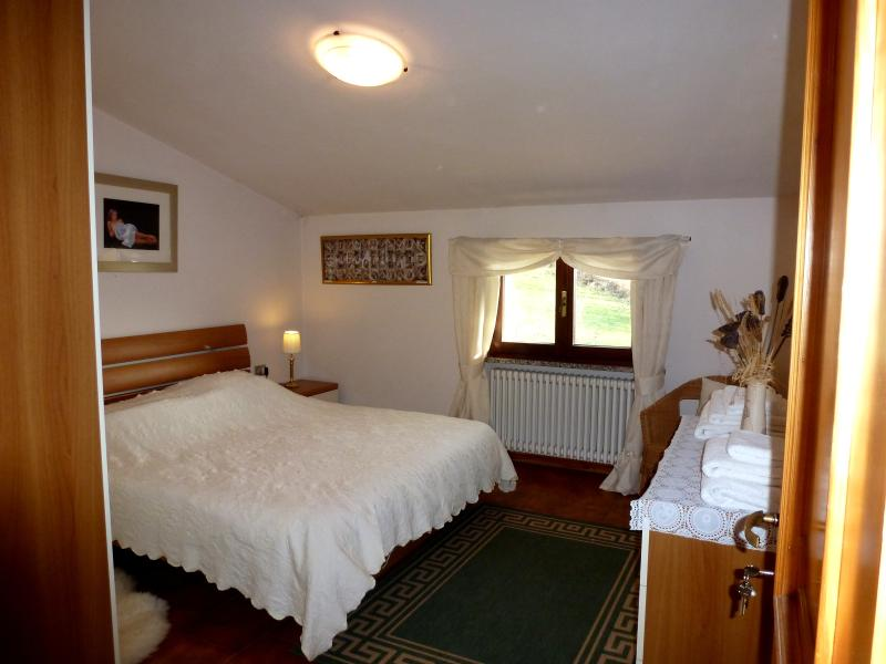 Spacious double bedroom on the second floor with views over the beautiful garden and woodlands.