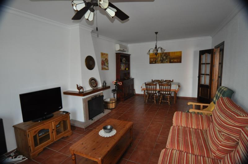 Living room with flat screen tv and A/C