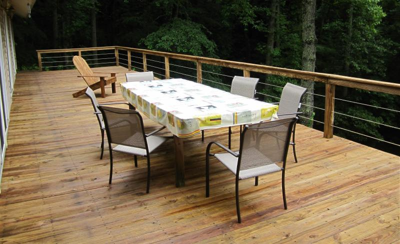 A freshly cleaned deck and new chairs await your arrival.